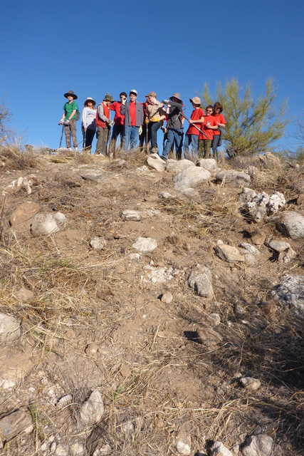 The Catalina State Park Buffel Slayers group at the top of a cleared hill